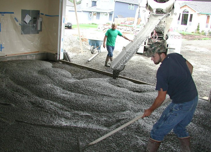 Welcome your new concrete floor! After the old concrete is hauled away, and the structure is put into place, and the area is sectioned off, pouring the concrete is the next step