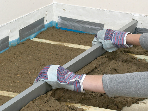 If you're doing a full conversion, this is a very important step in the process. In order to make sure that the garage blends seamlessly into the existing house structure, the gap between the floors needs to be removed. Even if you're opting for a remodel, any time concrete or flooring is installed, it must be carefully leveled to ensure an even floor with no raised or lowered sections.