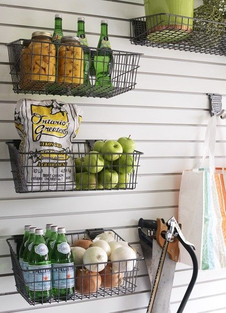 Take household supplies and put them into wire baskets. Wire baskets offer visibility that totes and crates may not.