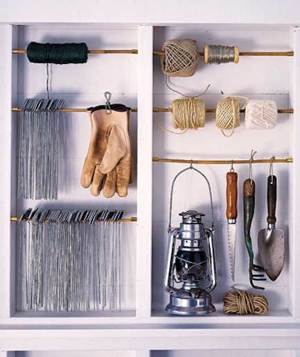 If your studs are visible, an easy solution for vertical storage is to use curtain rods! Hang tape, clothes, tools etc- and all for pennies on the dollar