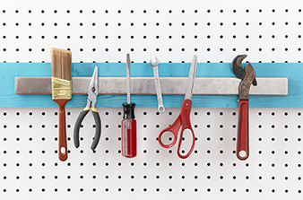 There are many ways to store items in the garage, and we find that using a magnetic strip for your most commonly used tools makes them easy to use, and youre more likely to put them away